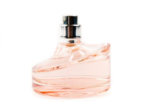 Bottle of perfume on the white background