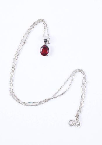 Necklace with the ruby stones on the white