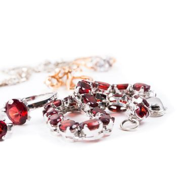 Bracelet with the ruby stones on the white
