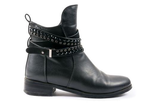 Elegant female leather shoe on the white