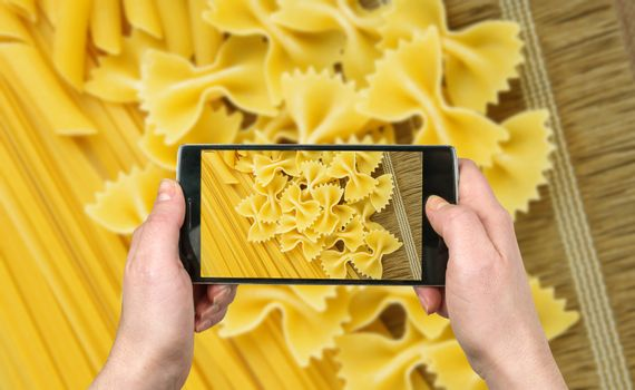 Taking picture with the phone. Pasta