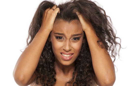dark skinned girl has itching in her hair