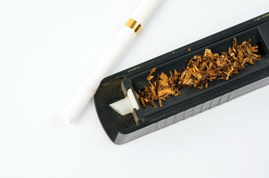 Tobbaco cigarette making machine on the white