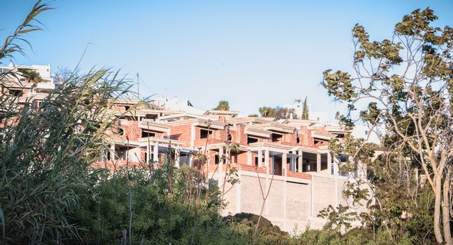 Albufeira, Portugal - May 3, 2018: Casa da Marina - a dream come true. Abandoned ruins of a luxury apartment building in a residence near the marina on a spring day