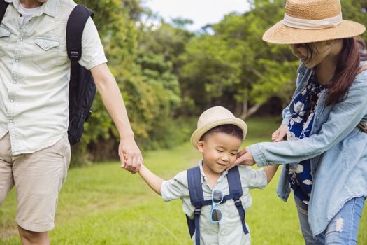 Shy boy and parent  hiking  in the park