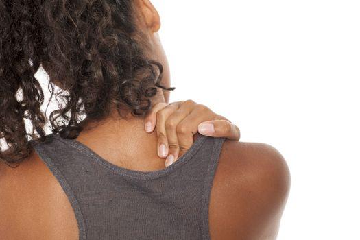 dark skinned girl massaging her neck