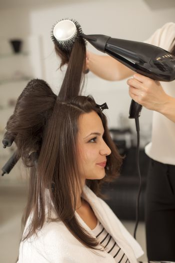 Hair drying and shaping  in hair salon