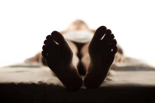female feet in shadow