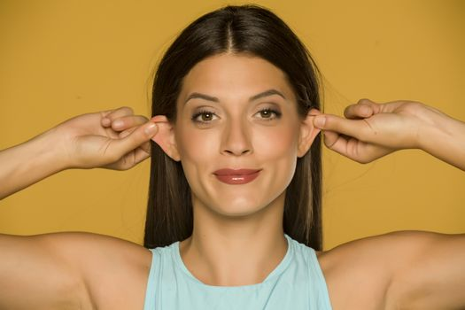 woman pulling her ears