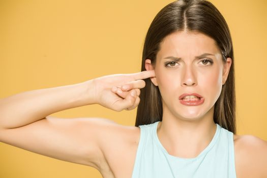 woman with the finger in her ear