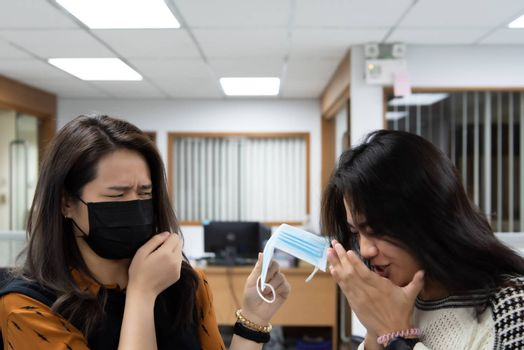 Asian pretty women wearing mask respiratory protection mask against epidemic flu covid19 or corona virus influenza in office with fear emotion in concept illness, outbreak, healthcare in life
