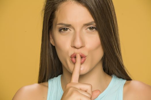 woman with her finger on her lips