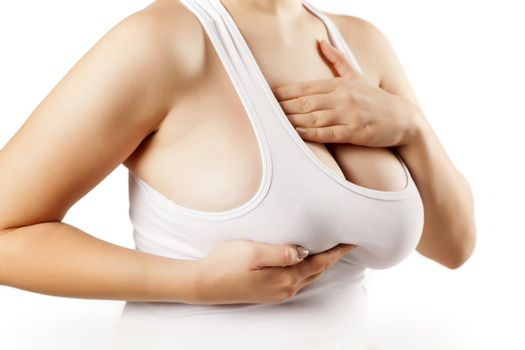woman touching her breasts through the shirt
