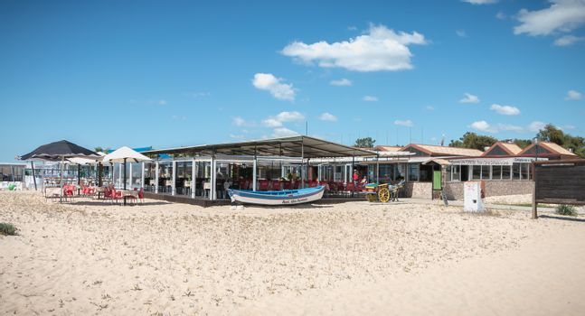 Tavira Island, Portugal - May 3, 2018: Tourist restaurant terrace on the island of Tavira in the beach town center on a spring day