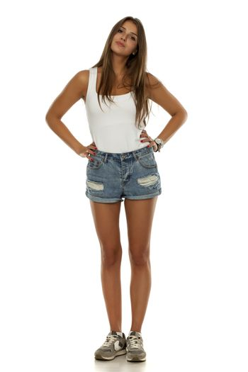 woman in shirt, short jeans and sneakers