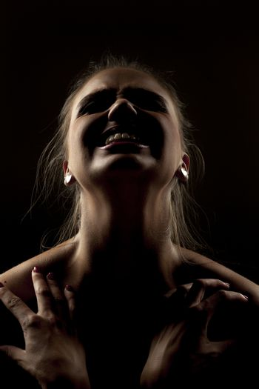 Sensual portrait of woman in shadow