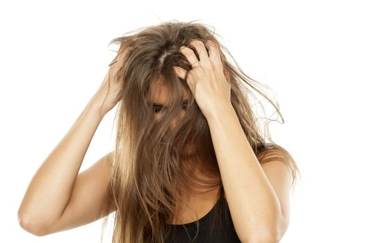 woman has itching in her hair