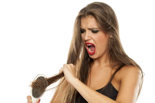 woman has a problem with combing