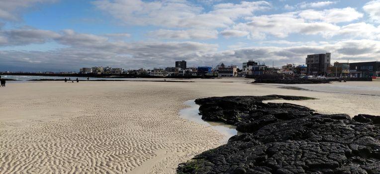 Landscape view of Hyeopjae beach cobalt blue sea