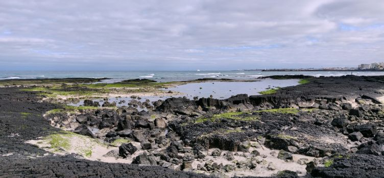 Hyeopjae beach filled with black cooled volcanic rock