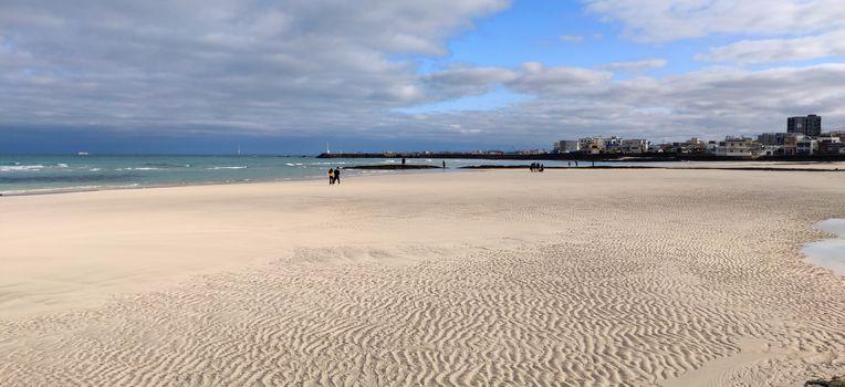 Water print on sand on Hyeopjae beach