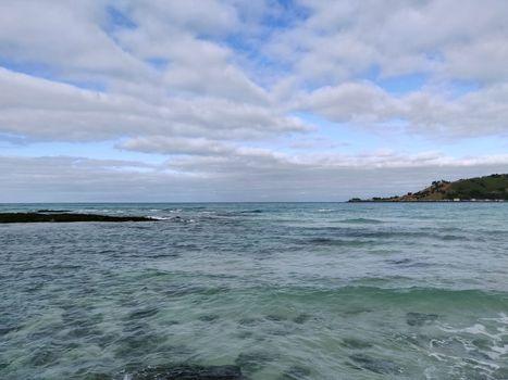 Landscape view of cobalt blue sea nd cloudy sky