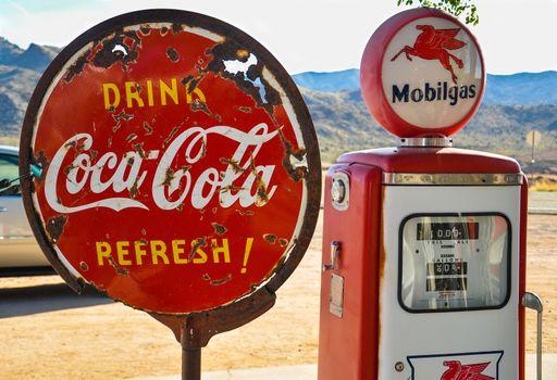 Retro gas pump and a rusty coca-cola sign on historic route 66