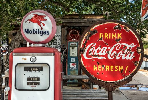 Retro gas pump and a rusty coca-cola sign on Route 66