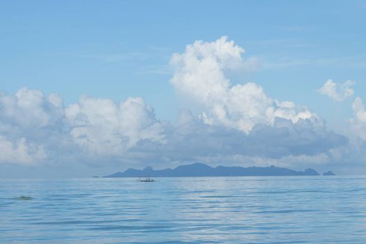 Summer seascape with blue sky background