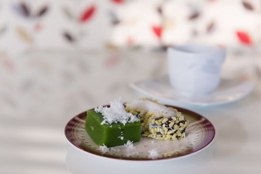 Traditional Thai dessert and morning coffee cup on white table