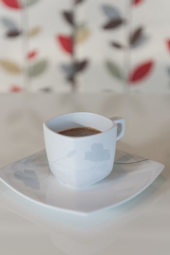 Morning coffee cup on white table