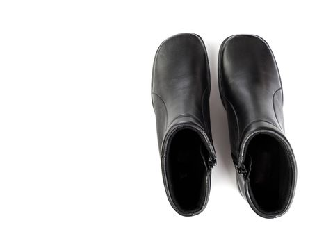 Black boot leather shoes isolated on white background