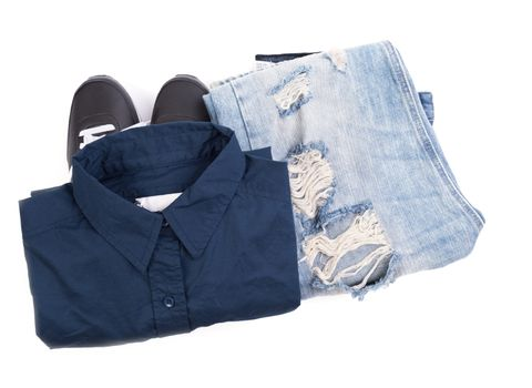Blue shirt, jean and sport shoes on white