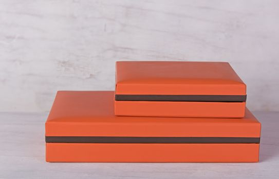 Orange gift box on grunge wood background