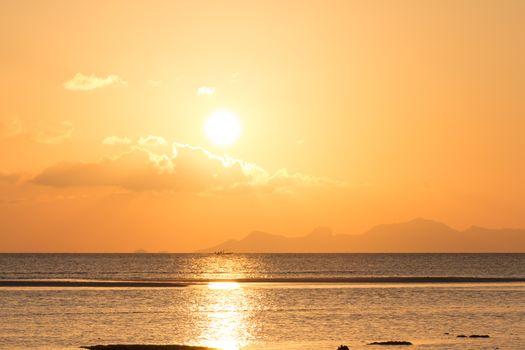 Golden orange sunset tropical sea background