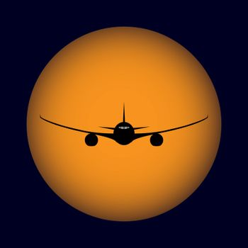 Air liner on the background of orange setting sun and blue sky