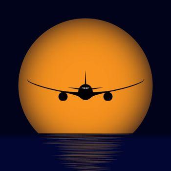 plane over the sea against the orange setting sun