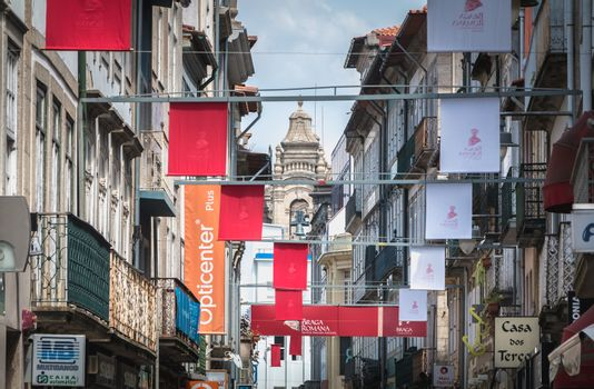 Braga, Portugal - May 23, 2018: View of a street in the historic city center decorated for the city festival Braga Romana on a spring day