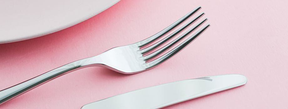 Empty plate and cutlery as mockup set on pink background, top tableware for chef table decor and menu branding design