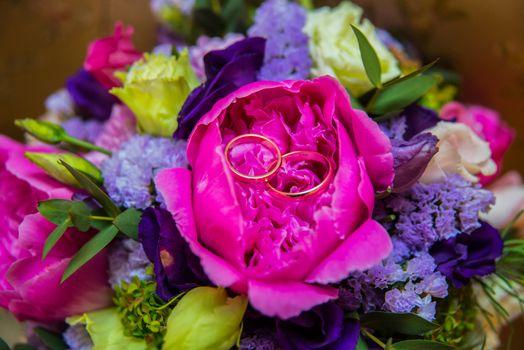 Beautiful gold jewelry lying around flowers Wedding Love