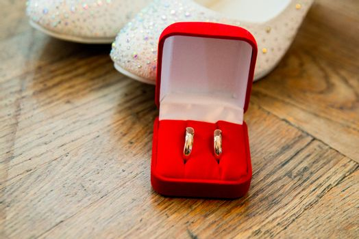 A beautiful engagement ring and bridesmaid shoes in wedding day