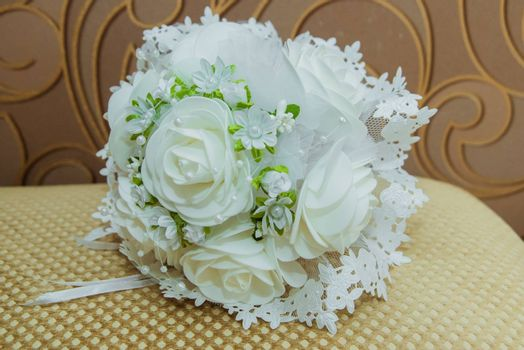 Bride's bouquet of white roses of artificial flowers.