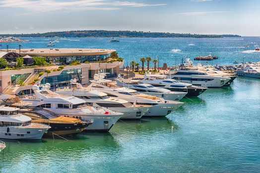 View over luxury yachts of Vieux Port in Le Suquet district, city centre and old harbour of Cannes, Cote d'Azur, France