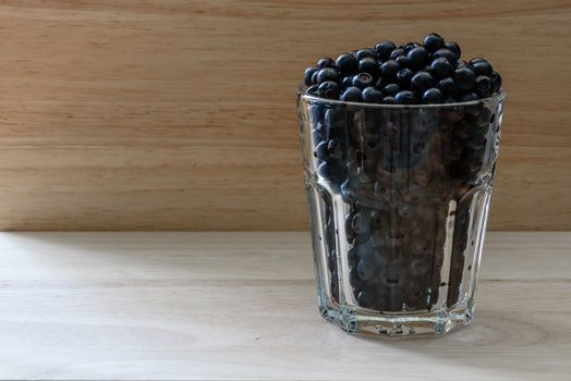 Blueberries in a glass. Charge of vitamins for the day