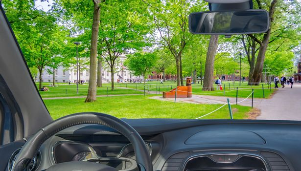 Looking through a car windshield with view of the Harvard University Campus, Cambridge, USA