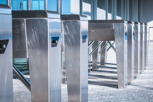 Turnstile. Checkpoint. Automatic access control. Access system to the building. Metal turnstile.