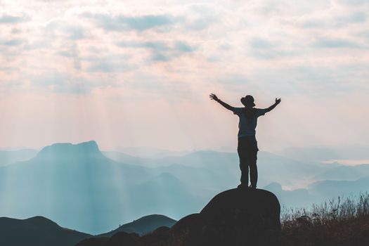 travels Silhouette on the peak of mountain,success concept