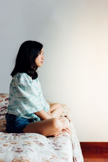 Woman on bed with loneliness and lonely feeling