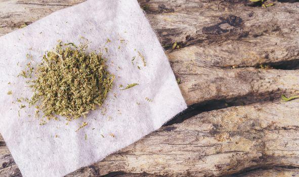 dried cannabis medical marijuana on wooden background