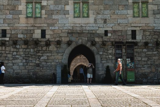 Guimaraes, Portugal - May 10, 2018: architectural detail of the Palace of the Dukes of Braganza next to the castle of Guimaraes that tourists visit on a spring day.